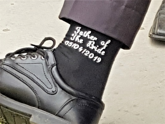 Father of the Bride HTV label on sock in the fun with labels
