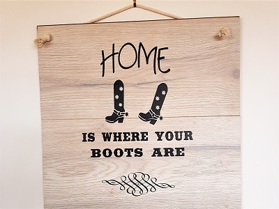 Home is where your boots are vinyl sign