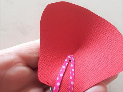 Tip to hold paper flower petal closed while the glue is drying