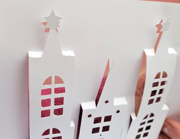 Close up view of the front of the unfinished pop-up castle card to view the folds easily.