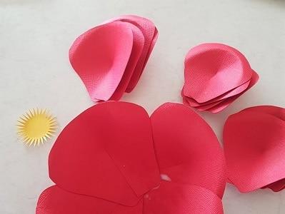 Paper flower petals glued around the circle