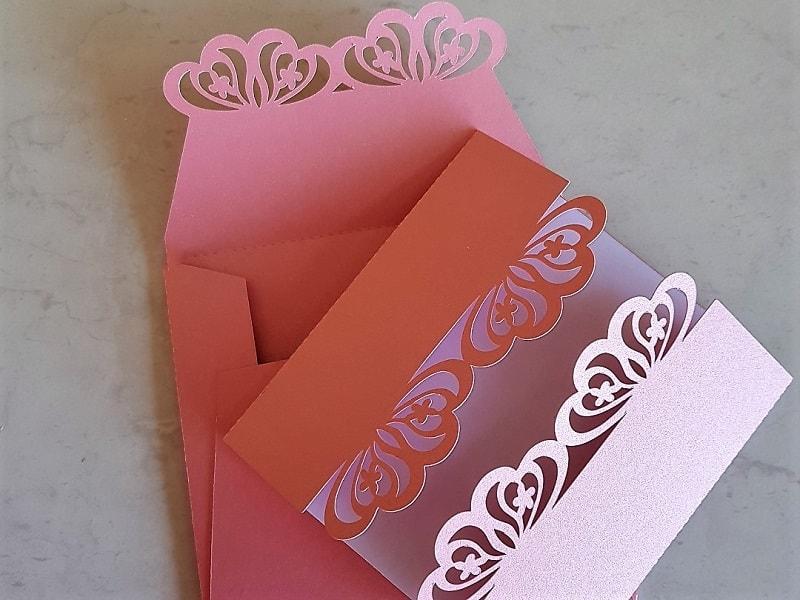 Pink edged laser cut wedding invitations