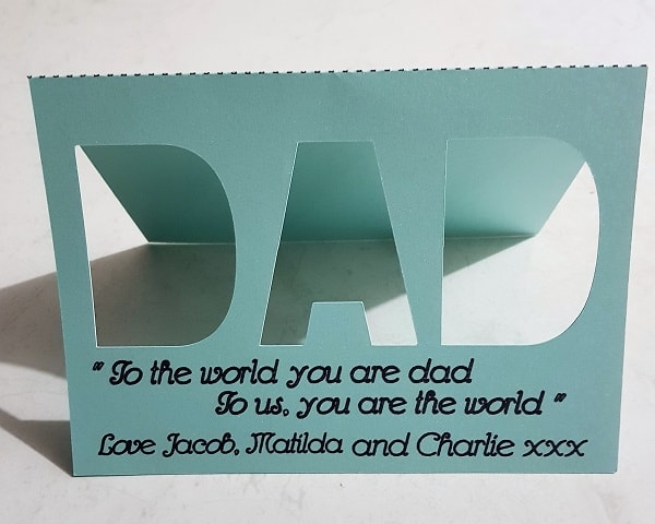 Cut out Father's Day card with DAD cut out and sentiment written on the front