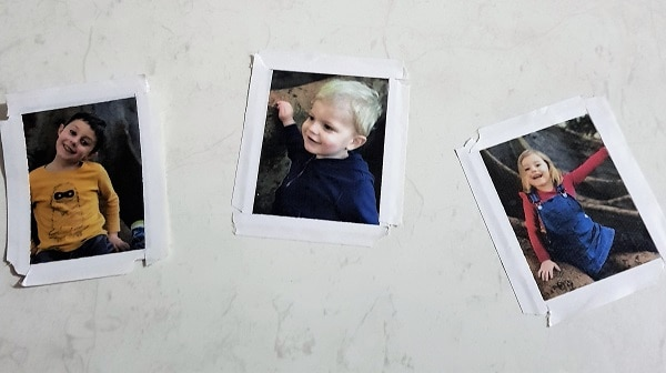 Small photos of kids for the Father's Day card with double-sided tape on them.