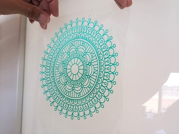 Weeded design only on the clear transfer sheet ready to place on design