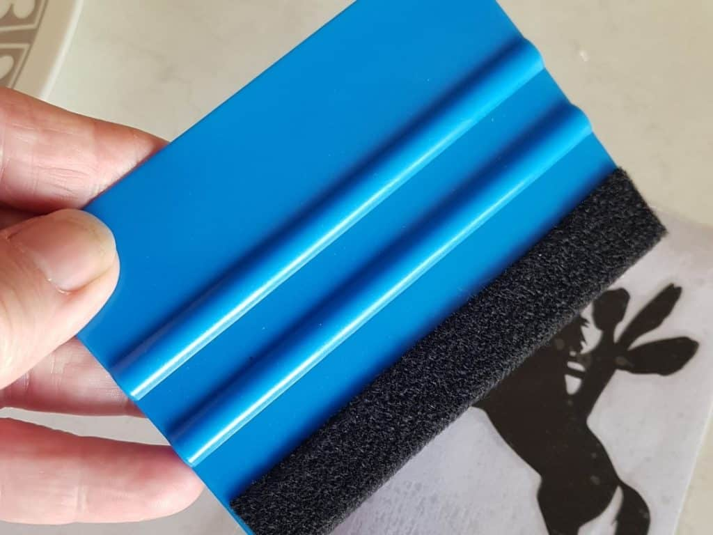 Squeegee tool to press vinyl firmly