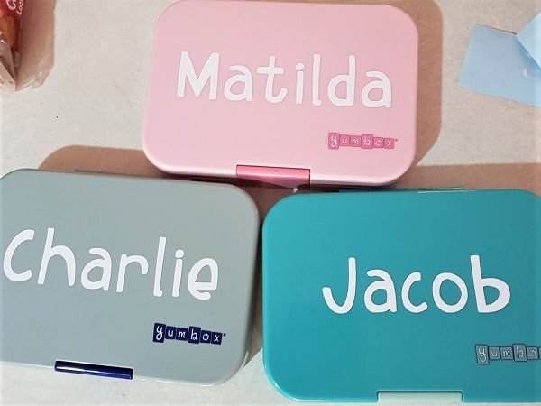 Lunchboxes labelled ready to go back to school.
