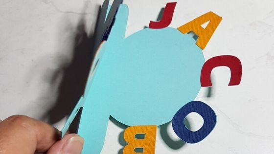 Inside of the curved text card with the colored letters already in place