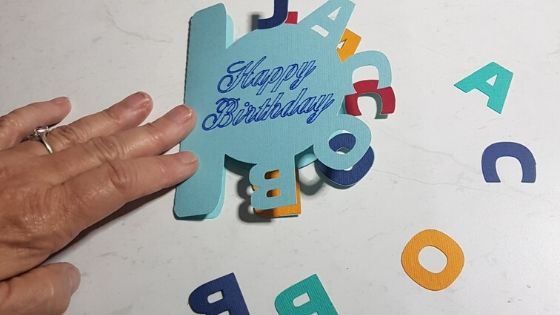 Curved text card made in Canvas Workspace nearly completed showing additional colored letters