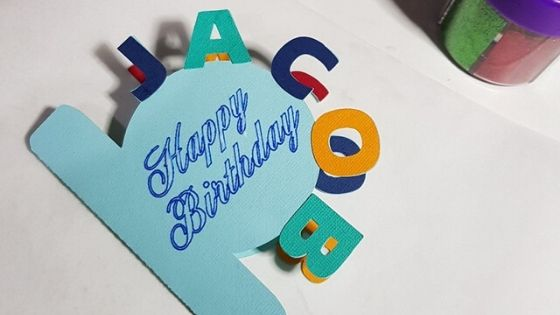Curved text card with additional letters placed on it