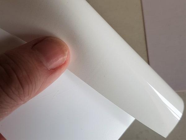 White heat transfer vinyl showing the shiny side.