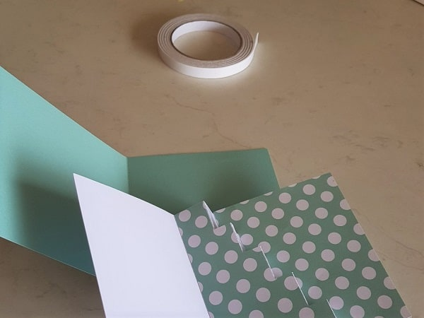 Double sided tape with the front and back section of the Step Card