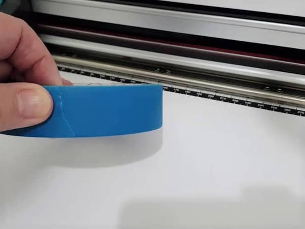 A roll of painters tape used to stop materials moving on the Scan N Cut mat.