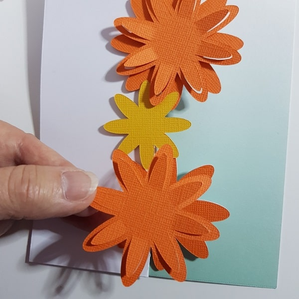 Each layer of the flowers being added to the 3D flower tri-fold card