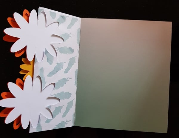 Inside of the 3D flower tri-fold card with patterned paper to embellish it.