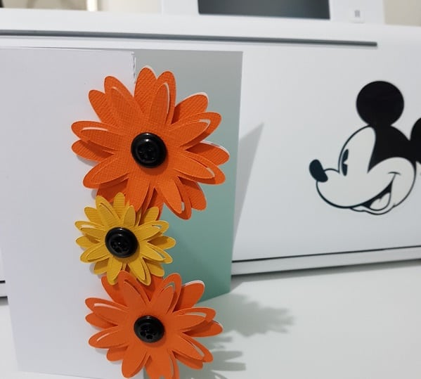 3D tri-fold flower card in front of the Brother Disney Scan N Cut cutting machine.