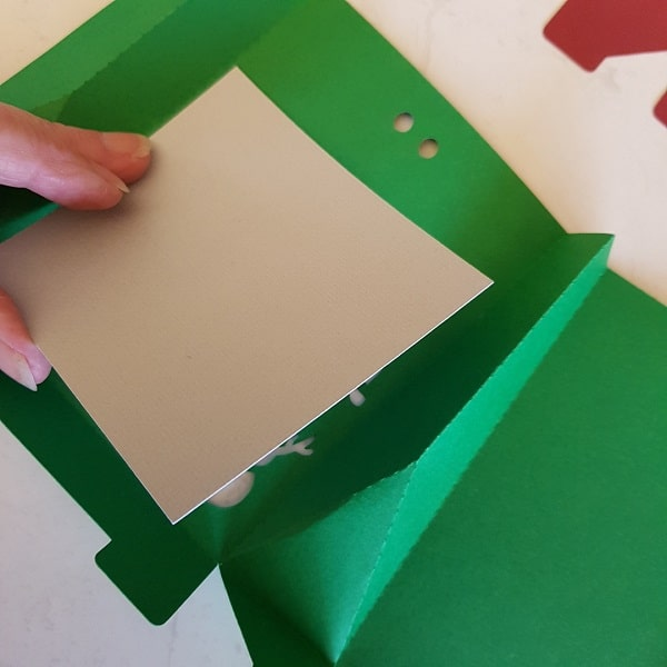 Glue the insert over the window area of the Christmas Gift Box