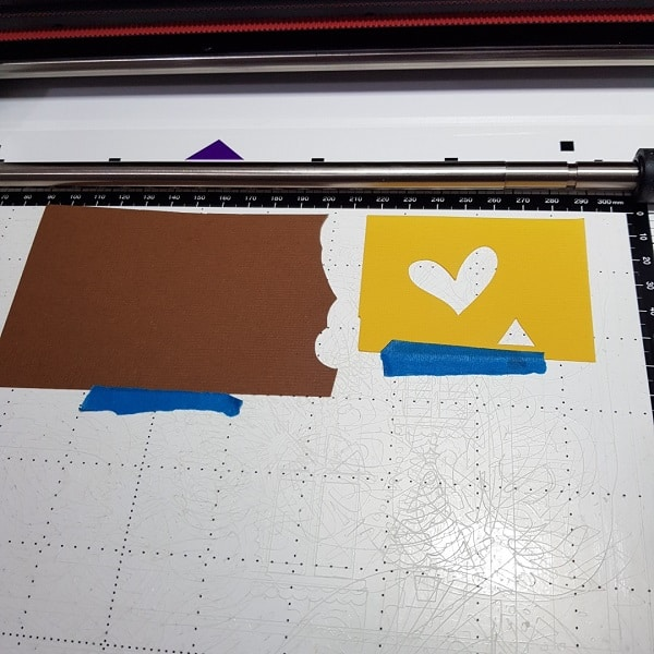 Scrap cardstock on the Scan N Cut cut mat ready to scan then cut out.