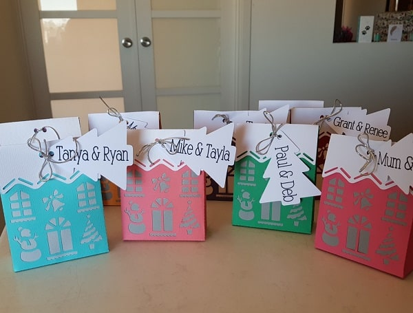 Lots of Brother Christmas House Boxes ready for Christmas gifts.
