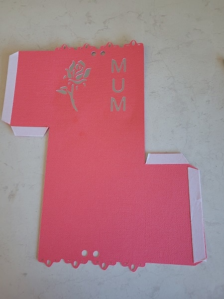 Gift box file cut out with double sided tape ready to stick the sides together and make the box.