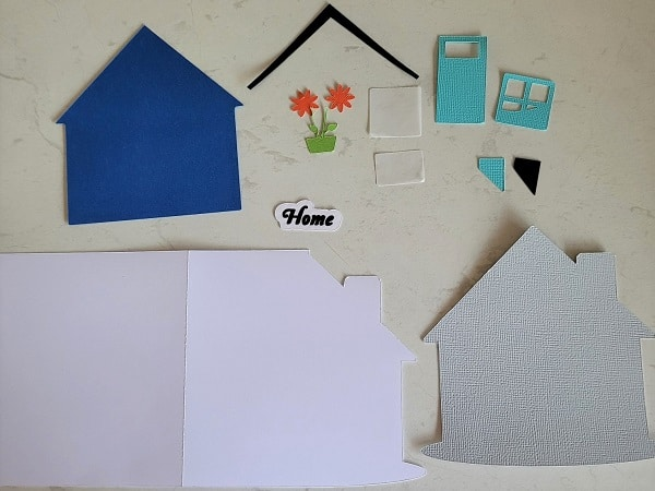 Here are all the pieces of the house and card cut out ready to put together