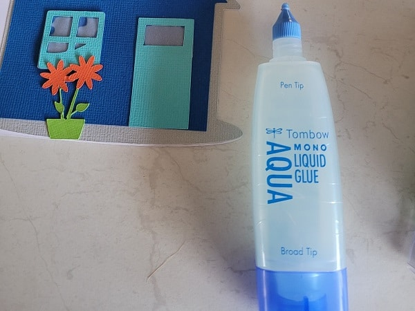 Tombow glue was used and it has a thin tip and fatter tip depending on what part of your project you are glueing.